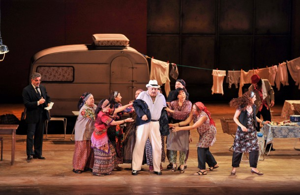 Characters congregate around the caravan in Christof Loy's witty staging of Il Turco in Italia. Photo: Antonio Bofill, courtesy of the Gran Teatre del Liceu